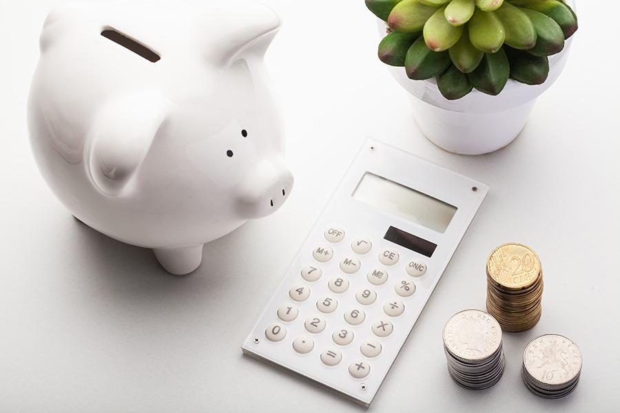 calculator, coins, piggy bank calculating home loans