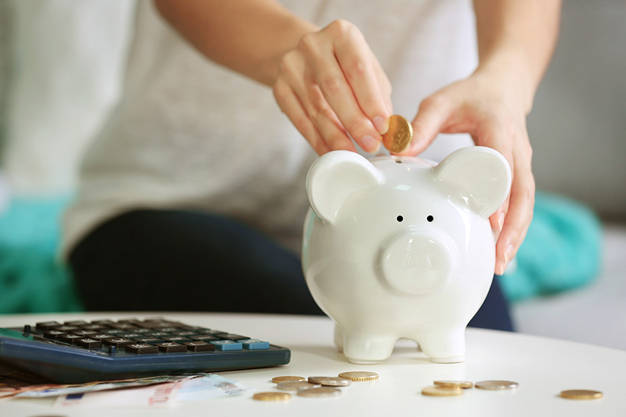 person using piggy bank for savings account